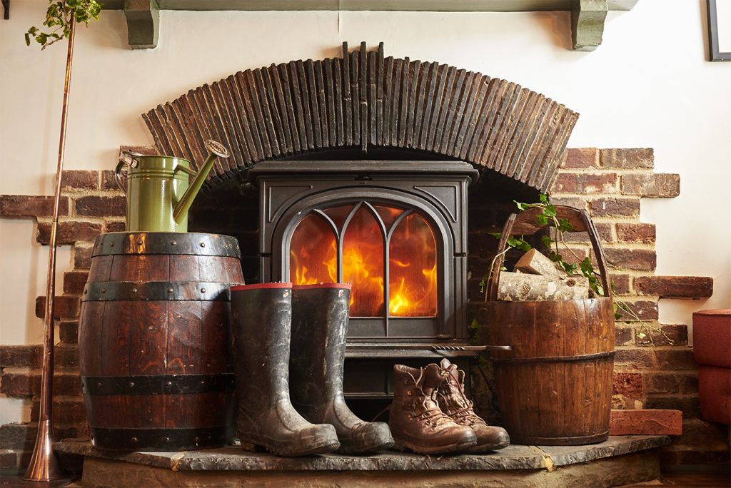 Warm wellie boots by the fire in The Half Moon Kirdford